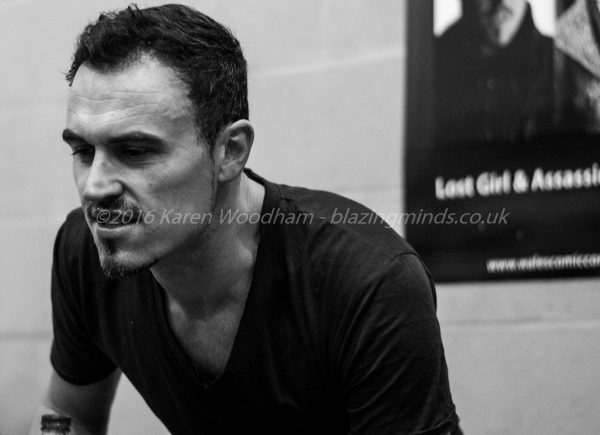 Paul Amos listening to a fan at Wales Comic Con 2016 Part 2