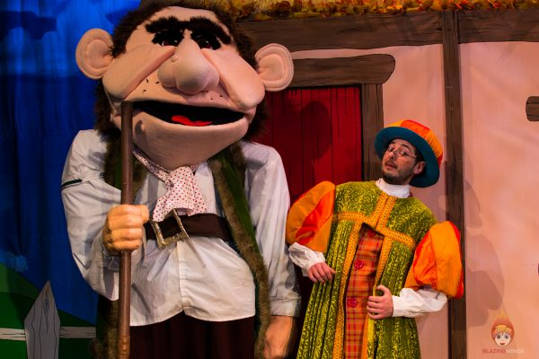 Dean Raymond as the giant and Lukas Kirkby (Squire Pumpkin) - Jack and the Beanstalk, Theatr Colwyn. Photo Karen Woodham