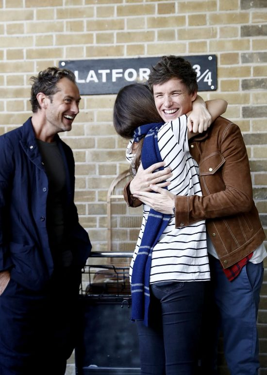 Eddie Redmayne and Jude Law, stars of Fantastic Beasts: The Crimes Of Grindelwald, surprise fans at platform 9 3/4 during 'Back to Hogwarts' day celebration at Kings Cross Station on September 1, 2018 in London, England.